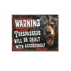 Warning Tresspassers tin sign